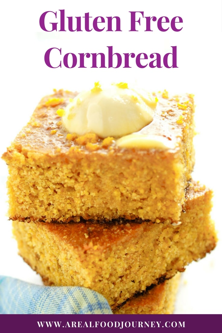 Three big squares of old fashioned cornbread topped with a melting pat of grassfed butter
