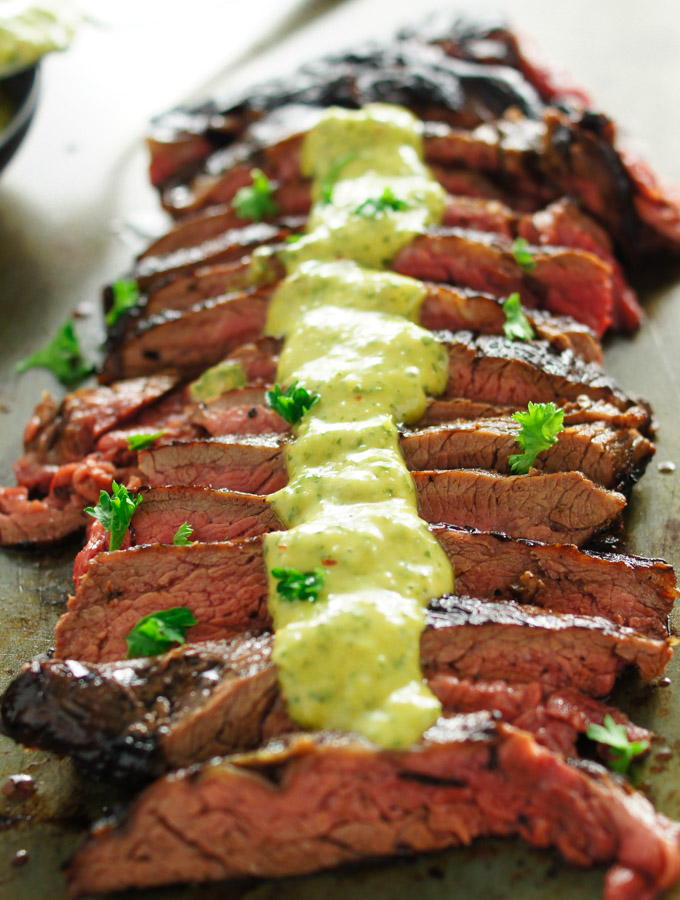 Chimichurri Aioli sauce drizzled over a grilled medium rare skirt steak