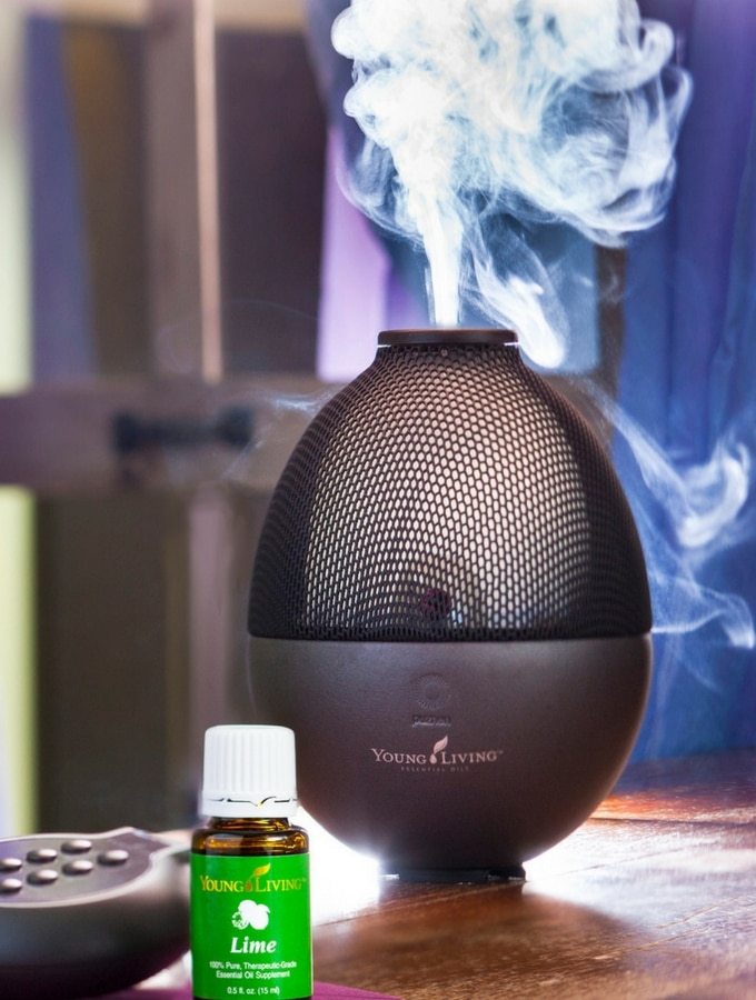 A black rainstone young living diffuser diffusing lime as part of aromatherapy oils for sleep