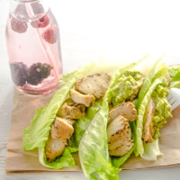 Three lettuce boats filled with johnsonville flame grilled chicken.