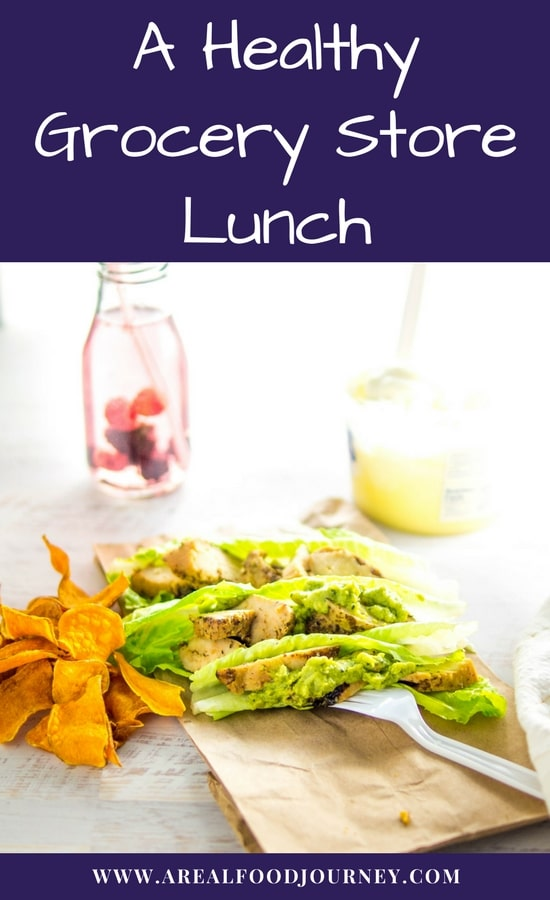 Grilled chicken on lettuce leaves with guacamole on a lunch bag with a side of yogurt.