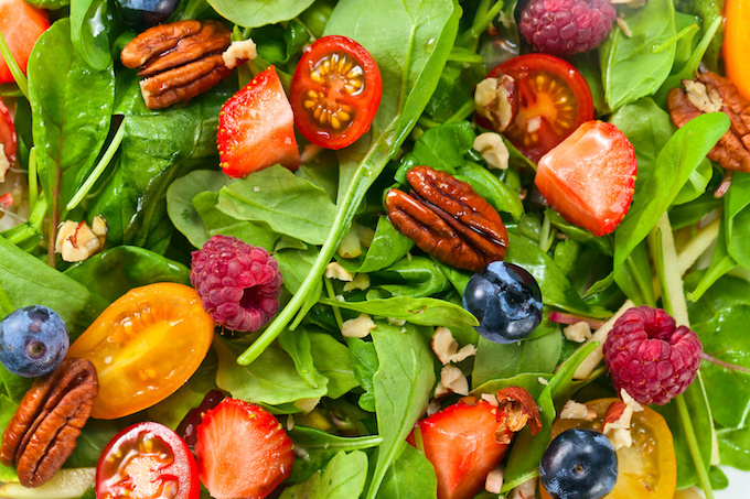 Green vegan salad with berries and nuts a keto meal