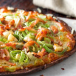 Low carb pizza recipe with bacon and leeks sprinkled with red hot peppers