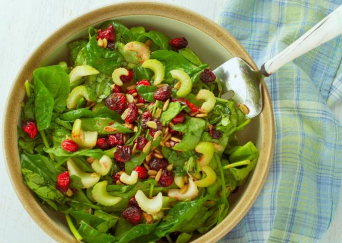 Roasted cranberries in green salad