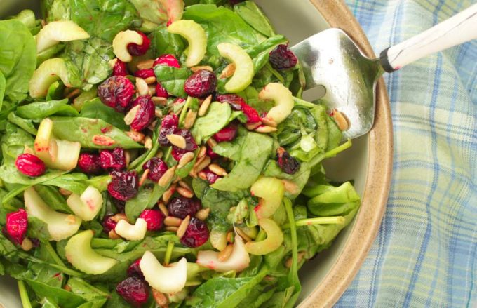Roasted cranberries in salad in a large bowl